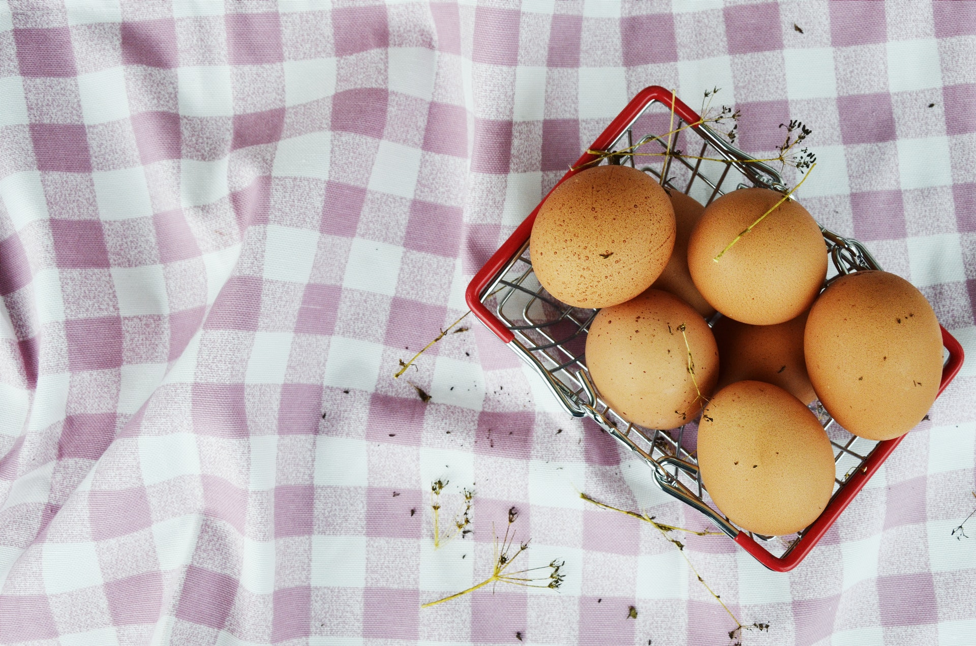 top-view-photo-of-brown-eggs-in-basket-2203058